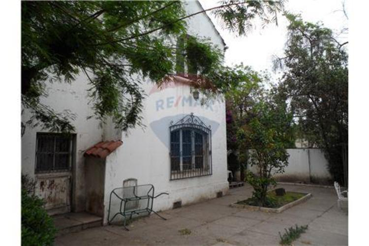 Casa Comercial Parque Bustamante / Sta Isabel